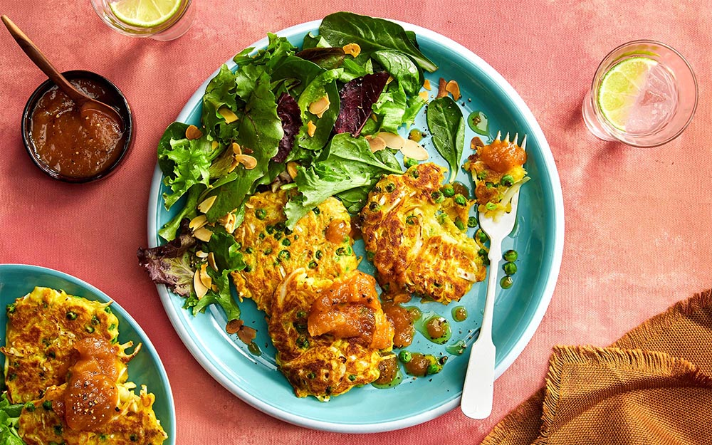 Savoury Indian Fritters with green peas, mango chutney and baby greens,