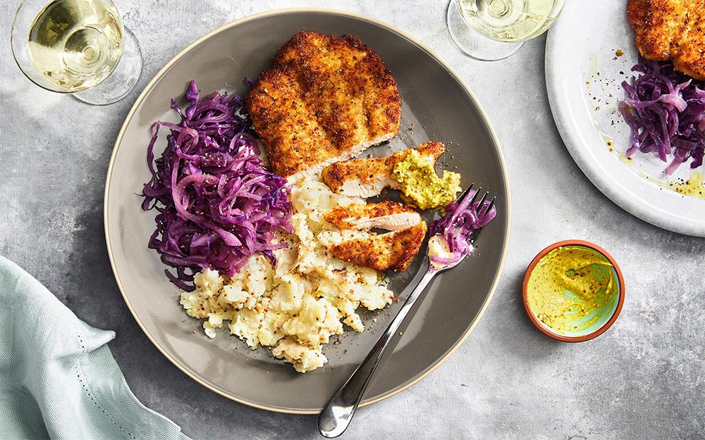 Bavarian Chicken Schnitzel with sour cream mash and curry remoulade,