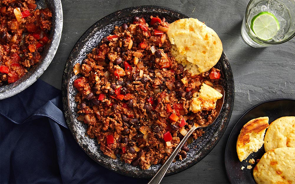 Beef & Black Bean Chili with cheesy baked cornbread biscuits,