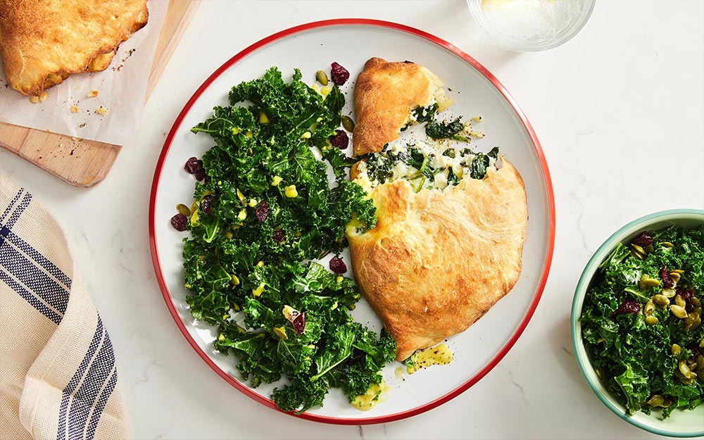 Ricotta Stuffed Calzones with mozzarella cheese & kale salad,