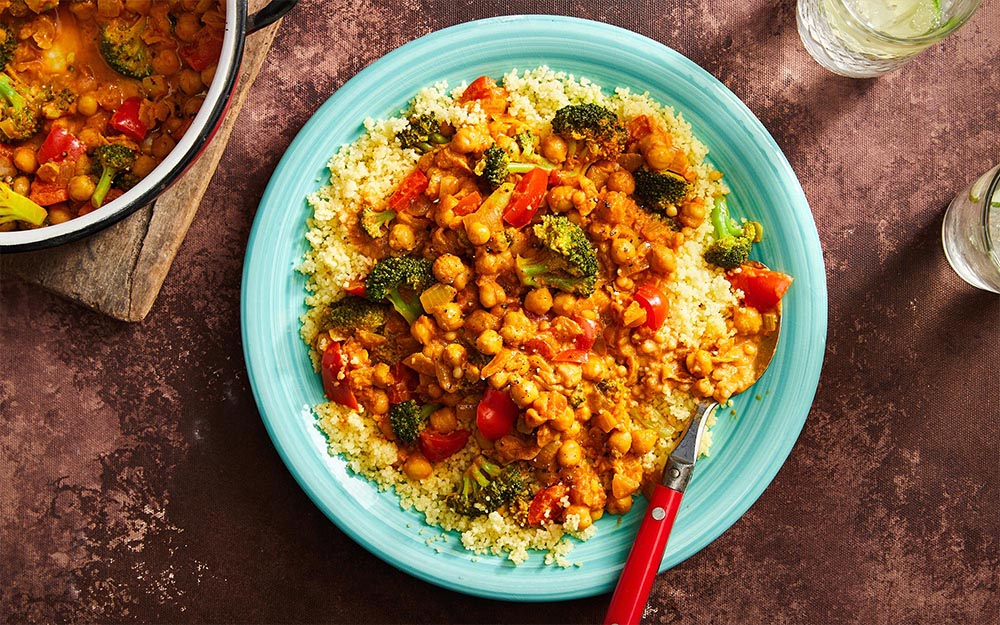 Chickpea Tikka Masala with broccoli, peppers and couscous,