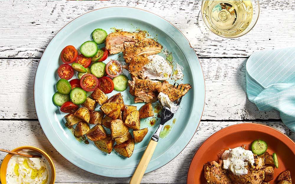 Chicken Souvlaki & Garlic Yogurt Sauce with roasted Greek potatoes and a chopped tomato salad,