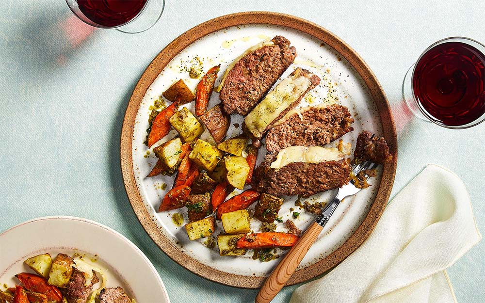 Baked Beef & Cheese Meatloaf with vegetables tossed in a pesto vinaigrette,