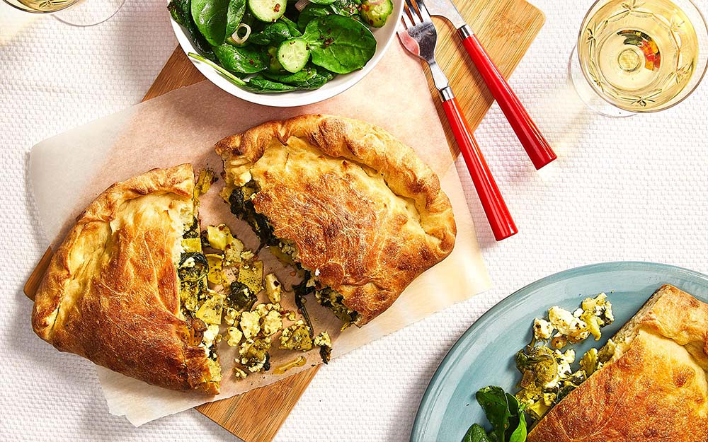 Greek-style Spanakopita Calzones with feta, spinach and artichokes,