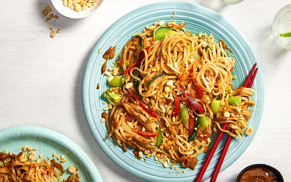 Peanut Pad Thai with bok choy, carrots and rice noodles,
