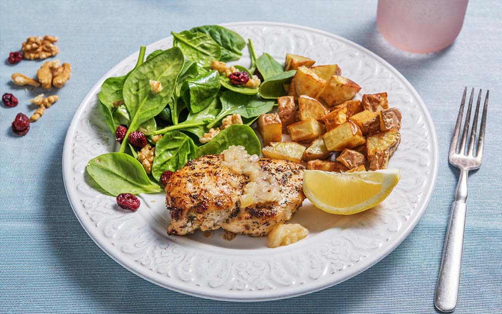 Herbed Roasted Chicken with onion chutney and walnut-cranberry salad,