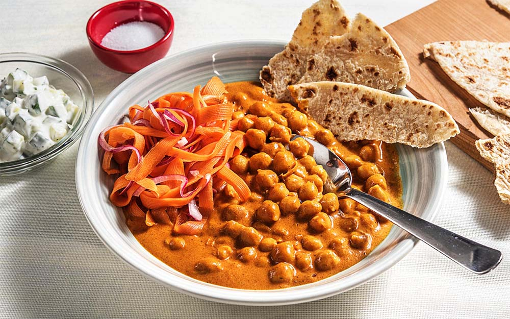 Butter Chickpea Curry with cucumber raita and carrot salad,