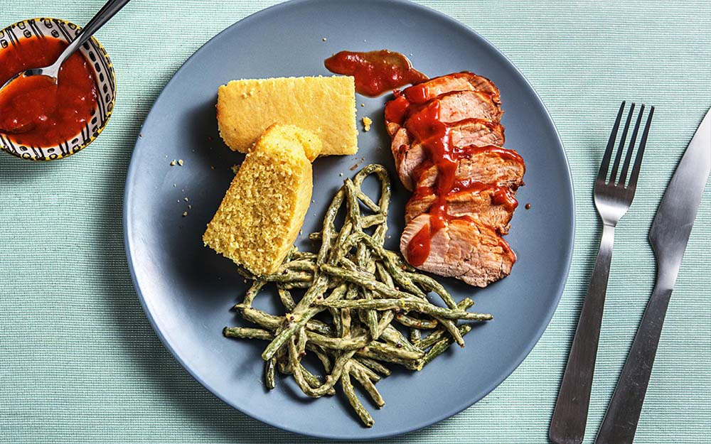 Paprika Glazed Pork with baked green beans and cornbread,