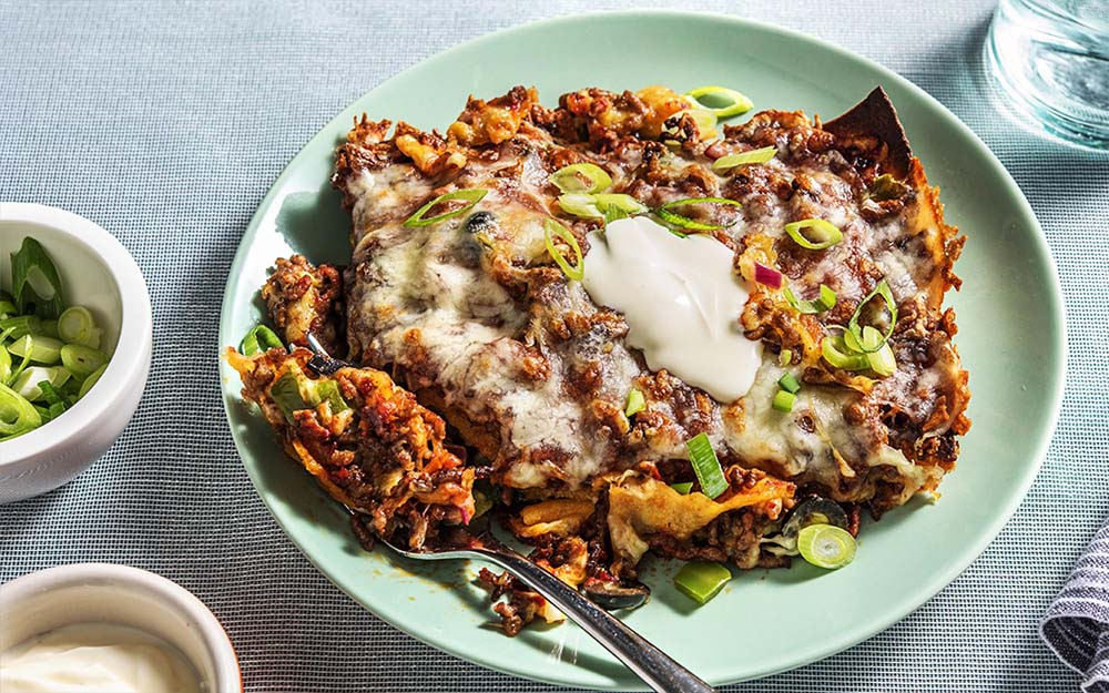 Tex-Mex Beef Lasagna with poblano peppers and a cheesy crust,