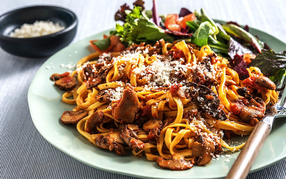 Mushroom Bolognese with fettuccine, parmesan and baby greens,