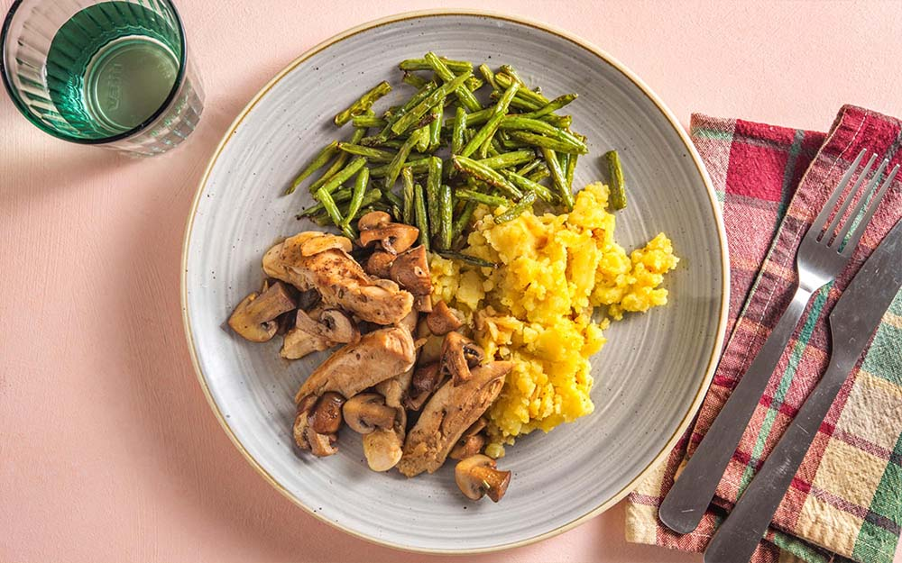 Montreal Spiced Chicken with creamy mashed potatoes and roasted green beans,