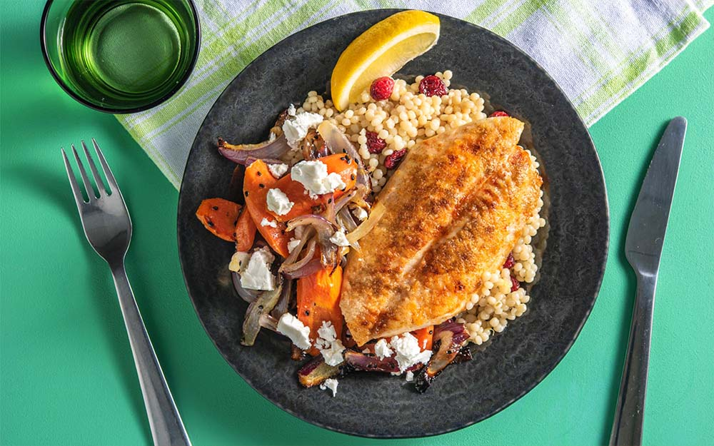 Baharat Spiced Basa with roasted carrots and lemon couscous,