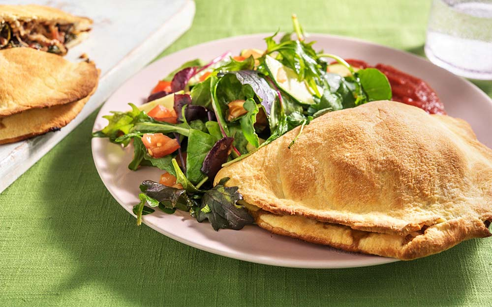 Veggie Calzones with marinara dipping sauce and salad,