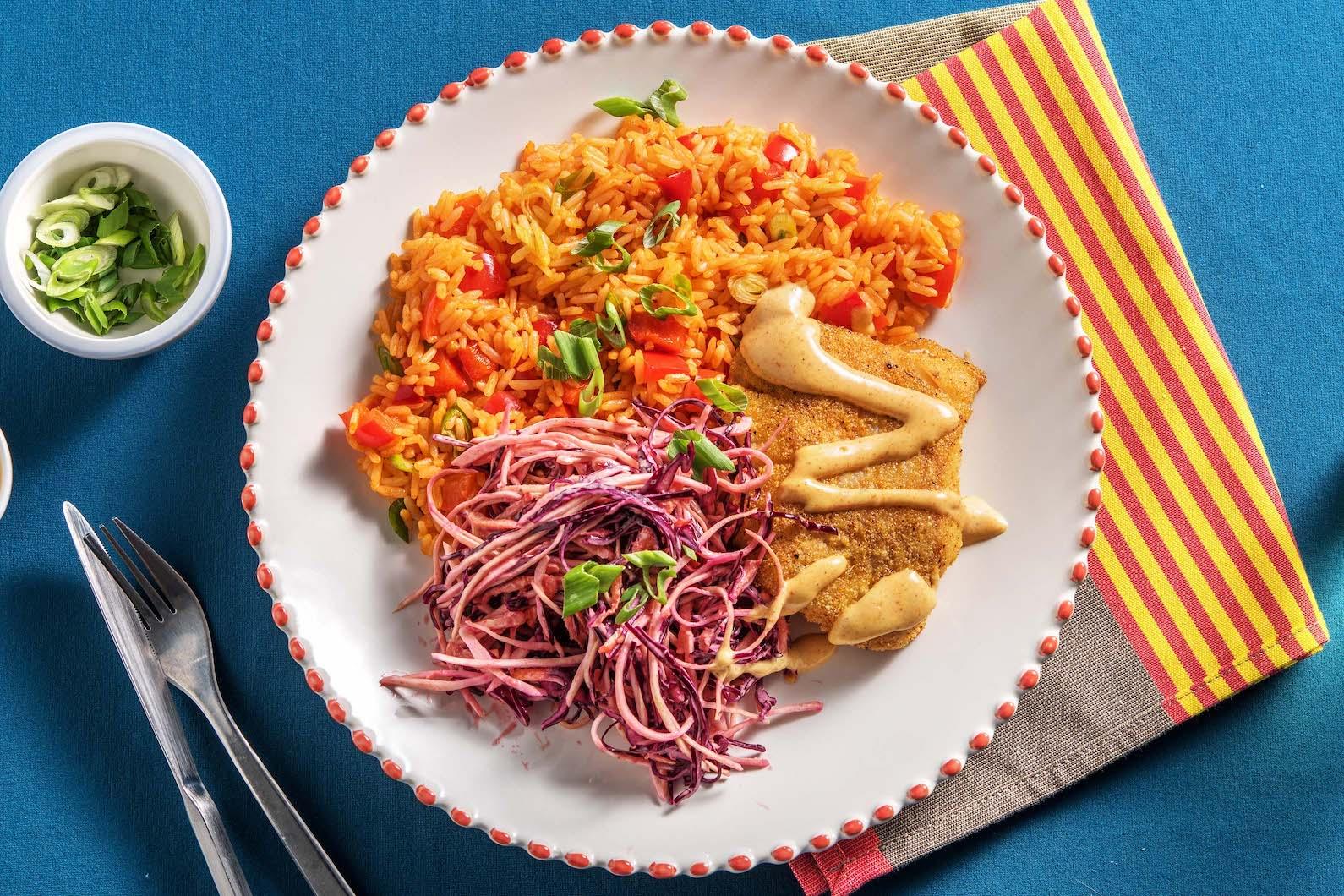 Cajun Haddock with rice pilaf and smoky remoulade sauce,