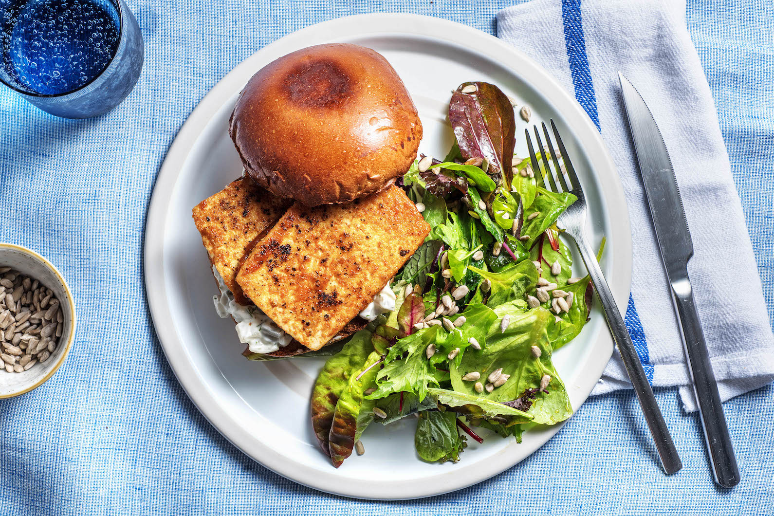 Buffalo Tofu Sandwiches with a baby green salad and dill mayo,