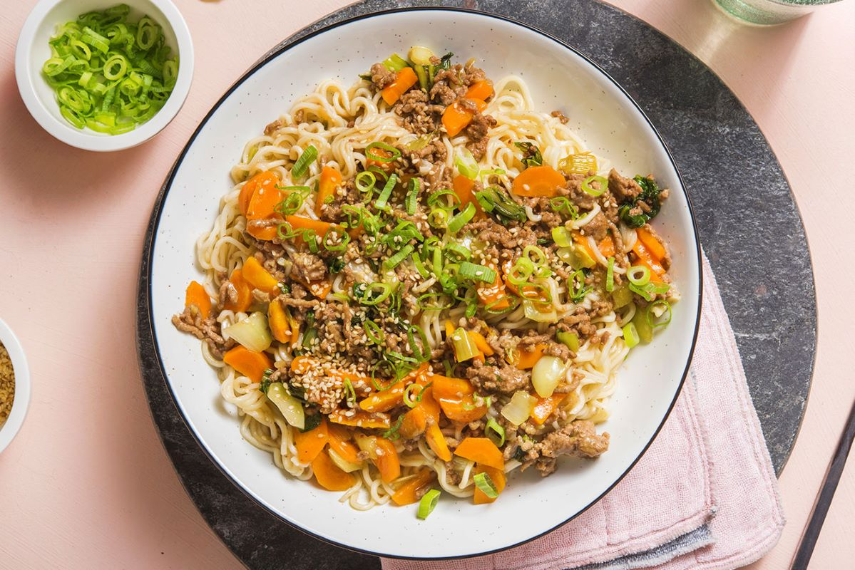 Spicy Sesame Beef Noodles with stir-fried veggies and sriracha