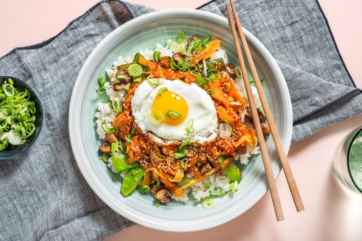 Mushroom Bibimbap Bowl with sticky rice and gochujang drizzle