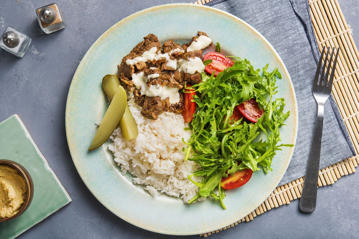 Beef Shawarma with rice pilaf and creamy garlic sauce