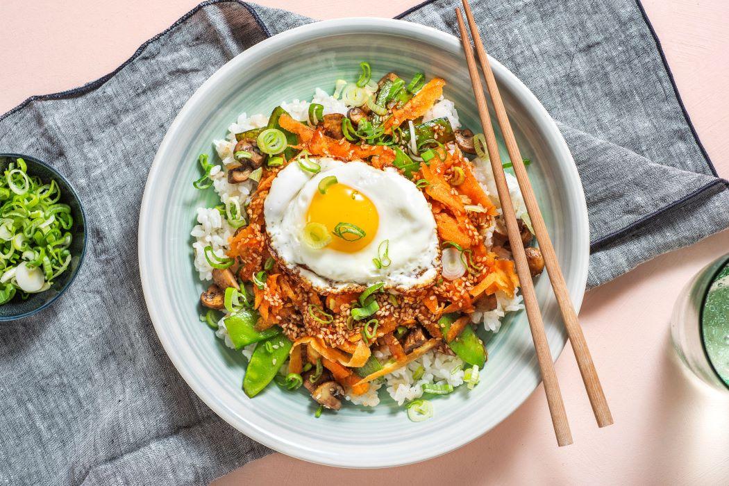 Mushroom Bibimbap Bowl with sticky rice and gochujang drizzle