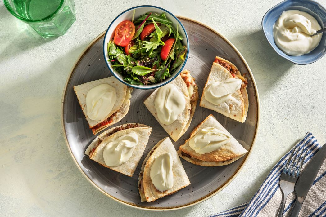 Cheesy Beef Quesadillas with sour cream, salsa and a green salad
