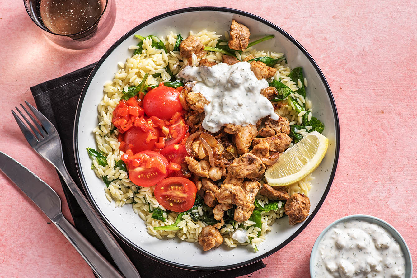 Pork Souvlaki Bowl with greek feta sauce and spinach orzo