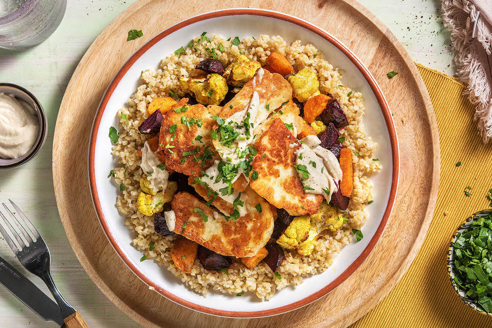 Cauliflower and Halloumi Grain Bowl over cracked wheat with garlic tahini sauce