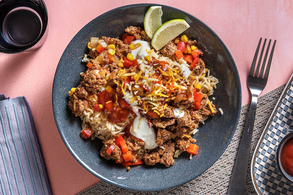 Mexican Beef Burrito Bowls with cheese, sour cream and salsa