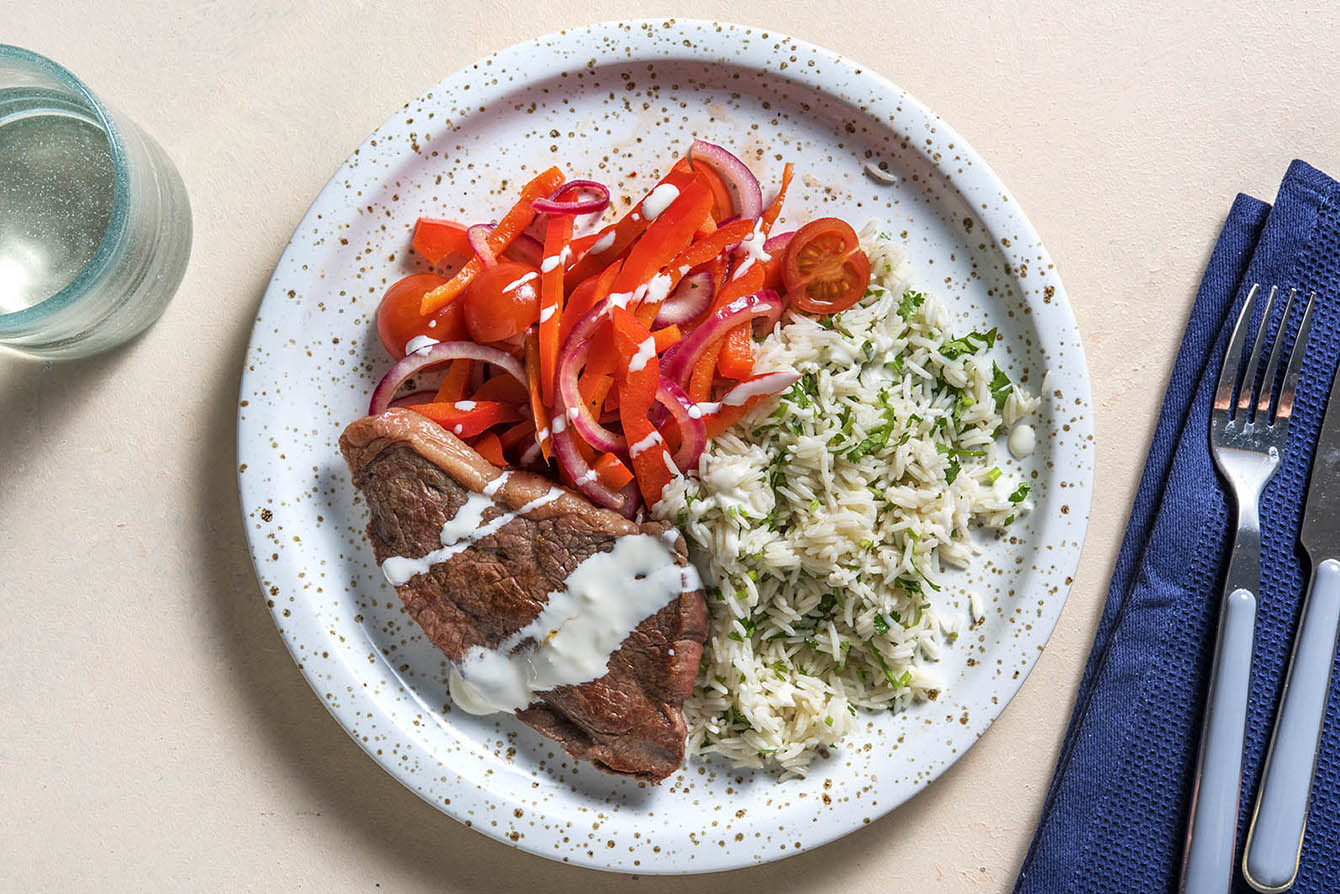 Spanish-Style Steak & Rice with charred peppers and garlic aioli