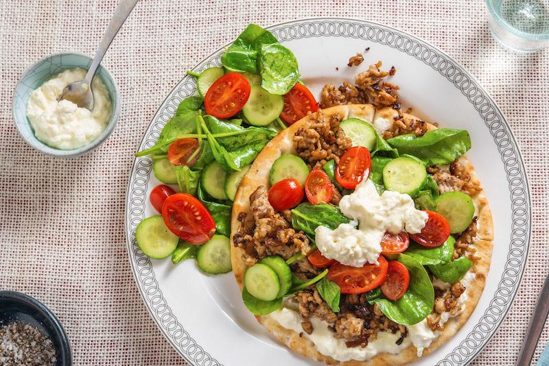 Pork Gyro Pitas with feta cream sauce and spinach salad